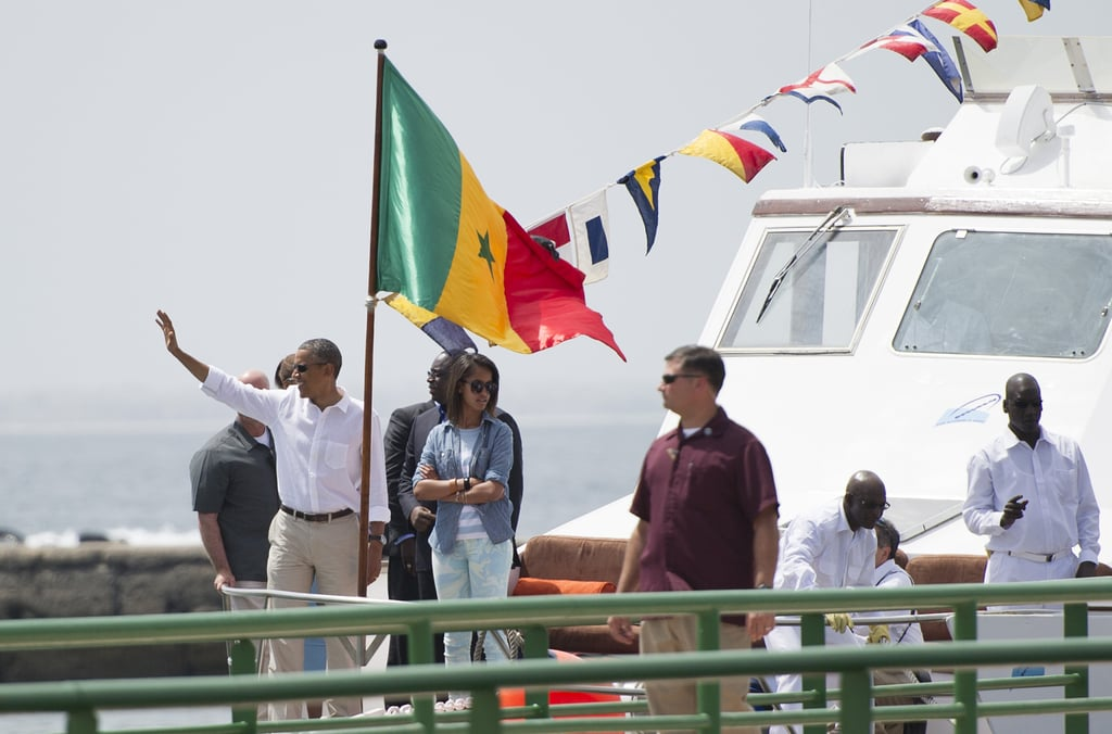 President Obama waved as he and Malia walked from a boat off the coast of Dakar in June 2013.