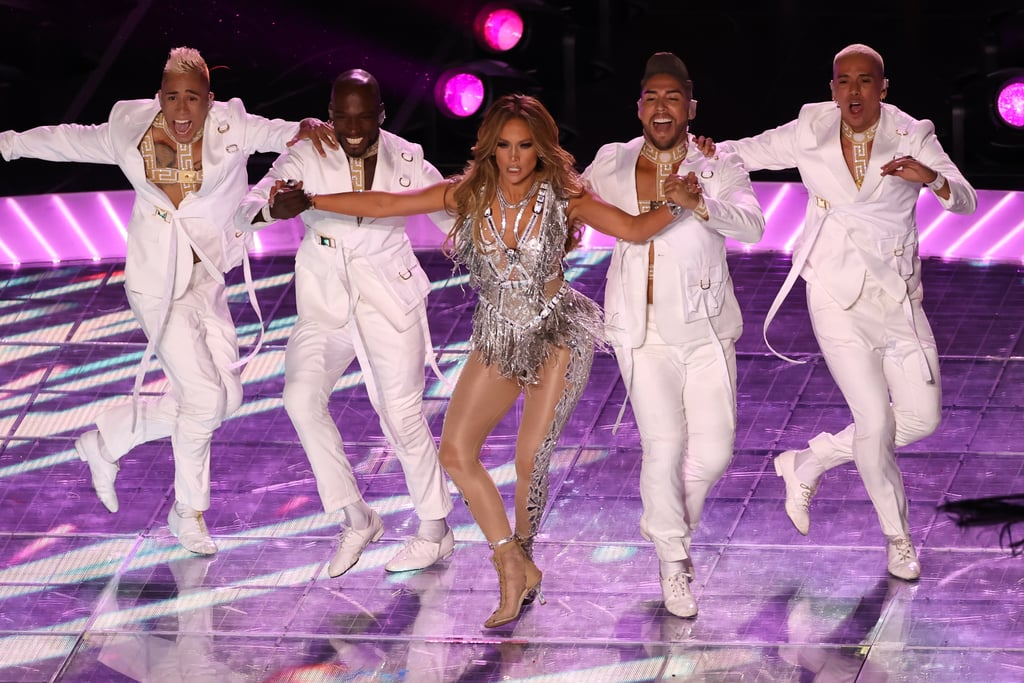 "Sure, football is a great sport, but many of us can agree that the real ""big game"" occurs during halftime. This year, Jennifer Lopez and Shakira took the stage for a medley of their respective greatest hits, and fans were blown away. J Lo is all about a fabulous performance outfit, and her multiple ensembles during Sunday night's game did not disappoint. She opened the performance in a stunningly sexy Versace leather bodysuit, and ripped it off to reveal a crystalized one-piece for her second outfit. She then strapped a bedazzled silver harness on top of the outfit, and boom, jaws were dropped. While we can't get enough of Jennifer's stunning performance outfits, we have to admit her daughter Emme stole the show when she appeared onstage during the final mashup of ""Let's Get Loud"" and ""Waka Waka (This Time For Africa)"" alongside her mama. Check out the photos of J Lo's applause-worthy halftime show outfits by Versace.      Related:                                                                                                           Relive Jennifer Lopez and Shakira's Sensational Super Bowl Halftime Show With These Photos"