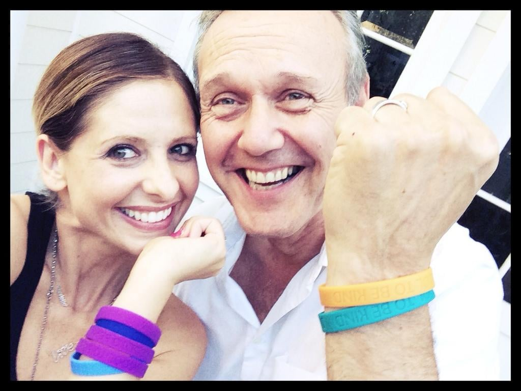 """Buffy the Vampire Slayer fans, are you sitting down? Because Sarah Michelle Gellar just staged an adorable reunion with her costar Anthony Stewart Head. The actress posted a silly selfie on Twitter with them holding up matching wristbands for the camera. """"@AnthonySHead Best surprise visit ever! It's #CoolToBeKind Thanks for the bracelets,"""" Sarah captioned the picture. Though Buffy and Giles's father-daughter-like relationship was never quite so goofy, we're not complaining. She then tweeted a picture of him holding a figurine of Buffy, since unfortunately Giles doesn't have his own toy version. Sarah has been on a roll with amazing Buffy reunion photos this year. In February, she shared a snap with Michelle Trachtenberg and Seth Green — who played her sister, Dawn, and her friend Oz, respectively —and then another with David Boreanaz, who played her love interest Angel. Source: Twitter user RealSMG; Front Page"""
