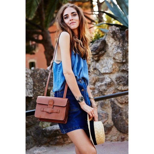 A Blue Top, Denim Skirt, and Brown Bag
