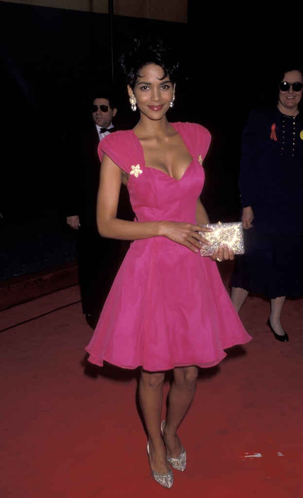 Halle Berry wore a bright pink dress in 1993.