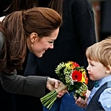 Kate let a little boy sniff the flowers he gave her during a walkabout in North Wales in November 2015.