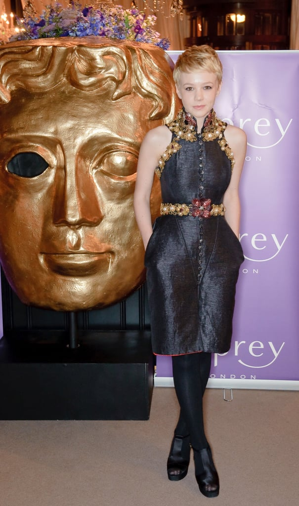 Carey stepped out of her poised comfort zone and toed the futuristic fashion line in a textured Chanel creation, complete with gold and ruby embellishments, at the BAFTAs in London.