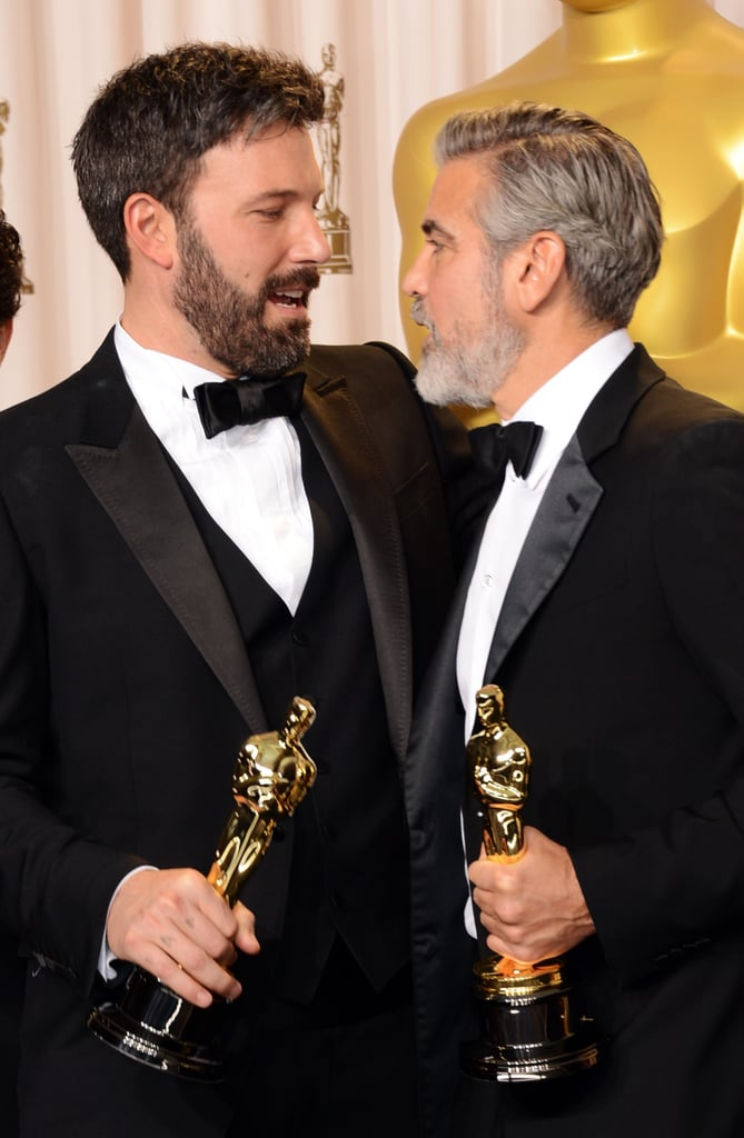 Ben Affleck and George Clooney celebrated together in the press room at the Oscars.