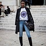 With a Logo Tee, a Military-Inspired Coat, Heeled Boots, and a Tote Bag