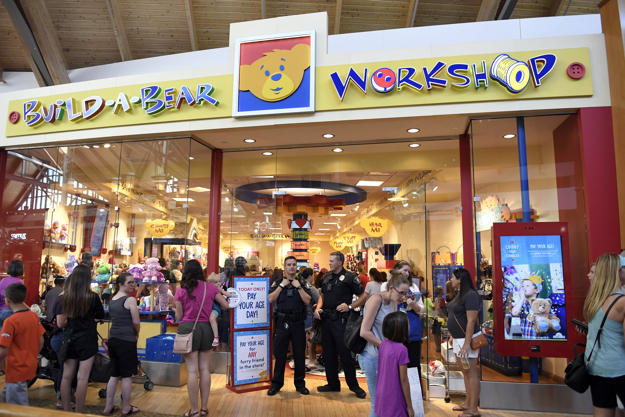 LONE TREE, CO - JULY 12: Lone Tree Police help at the front door of the Build-A-Bear store as lines stretched almost all the way around the second floor of Park Meadows Mall. Malls in metro Denver, Loveland and across the country shut down a promotion where plush bears could be purchased at a price matching a customers age July 12, 2018 in Lone Tree, Colourado. (Photo by Joe Amon/The Denver Post via Getty Images)