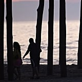 A couple takes an early evening stroll through Ocean City Pier in Maryland as the city's mayor orders a mandatory evacuation ahead of Hurricane Irene's arrival.