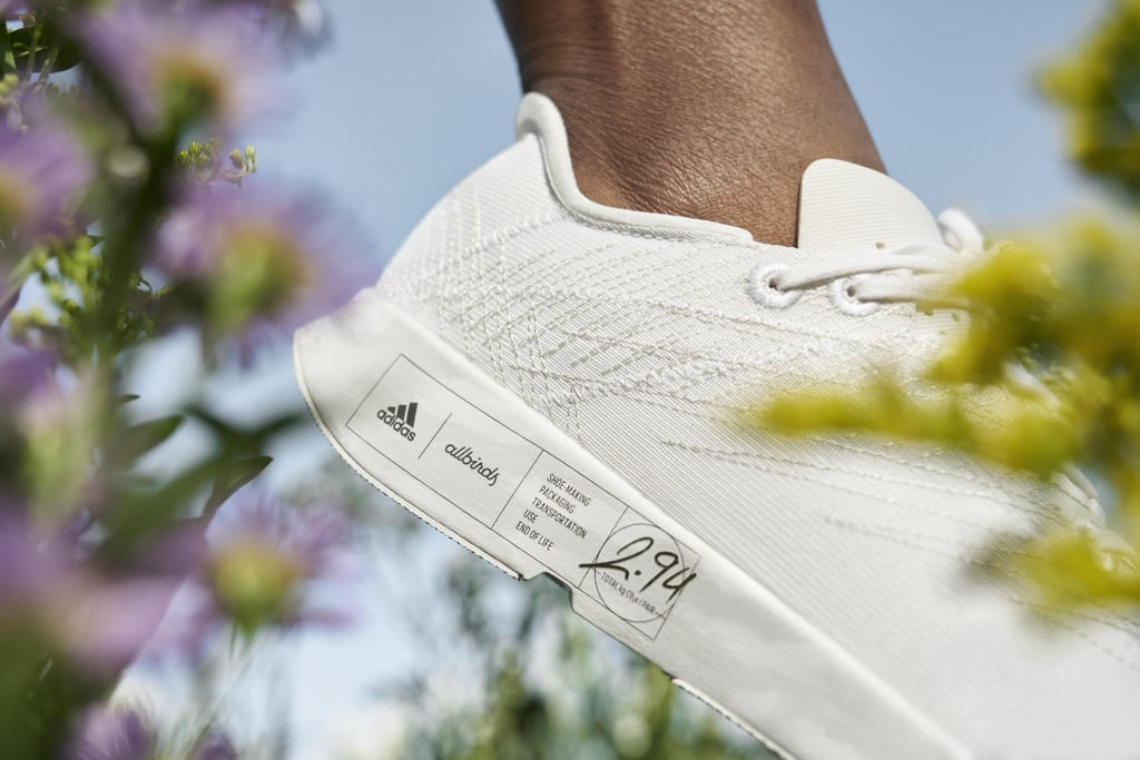 """What does it take for two rival sportswear companies to team up? How about a common goal: to create a top-quality product while lowering the carbon emissions needed to make it. That's what brought Adidas and Allbirds together, and the result is a crisp, all-white running shoe called Futurecraft.Footprint that the companies released today. The shoes' carbon footprint of 2.94kg CO2e represents the lowest reached by either brand, and Adidas and Allbirds say they didn't sacrifice quality to do it. It helps that Futurecraft.Footprint brings together proprietary technologies and materials from both brands, with a midsole based on Adidas's Lightstrike model blended with Allbirds's natural, sugarcane-based SweetFoam material. In a press release, Brian Grevy, an executive board member for global brands at Adidas, called the collaboration a """"call-to-action for other brands, and a milestone in the sports industry achieving carbon neutrality,"""" combining """"Allbirds' knowledge of carbon calculation and experience with natural materials, and Adidas' capabilities in manufacturing and performance footwear.""""  Adidas and Allbirds hope their achievement will inspire other companies to collaborate in the name of solving climate change, added Tim Brown, a co-founder and co-CEO at Allbirds. """"Our two teams have raced as one to create a shoe as close to zero carbon emissions as we could possibly achieve,"""" he said in the press release. """"The results are an exciting step forward, and hopefully, an example for others to follow."""" Futurecraft.Footprint is released today as part of a limited, 100-pair raffle for Adidas's Creators Club, with a wider release planned for later in the year. Check out more photos of the spotless, environmentally friendly shoes ahead!"""