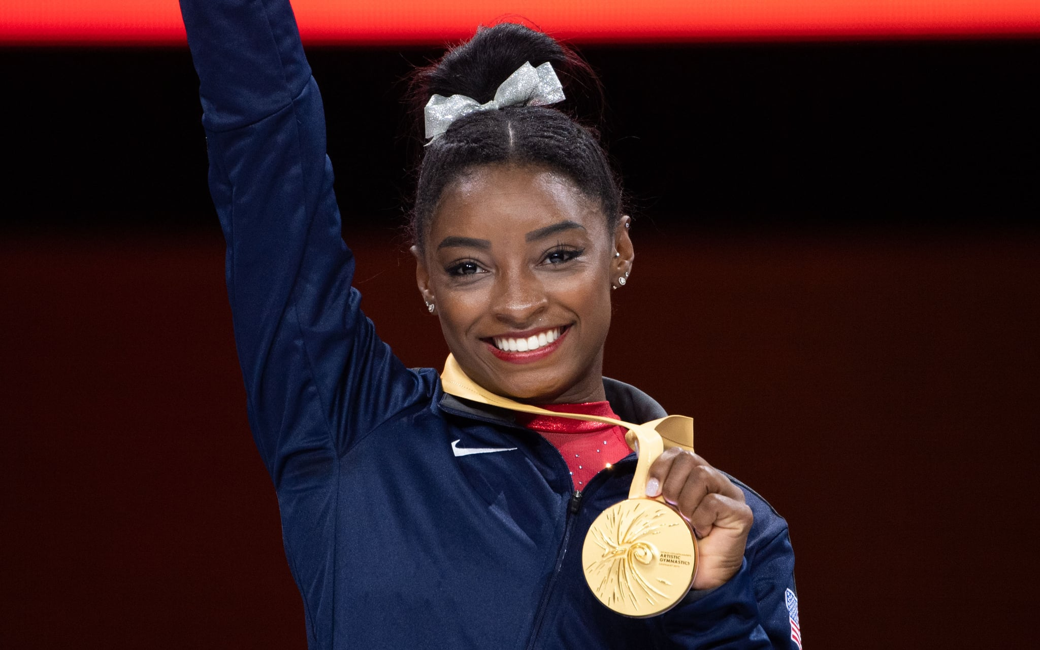 12 October 2019, Baden-Wuerttemberg, Stuttgart: Gymnastics: world championship, jump, final, women: Simone Biles from the USA at the award ceremony with the gold medal Photo: Marijan Murat/dpa (Photo by Marijan Murat/picture alliance via Getty Images)