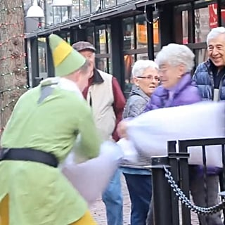 Man Dressed as Buddy the Elf Has Pillow Fights