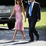 When the Trumps left the White House to participate in a rally in July 2017, Melania wore a bright pink Monique Lhuillier dress with matching Christian Louboutin pumps.