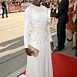 At the 12 Years a Slave premiere in Toronto, Lupita Nyong'o was a modern-day goddess in a white gown with gold embellishments. Her jewelled clutch was the perfect add-on to her regal look.