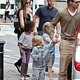 Brad and Angelina with kids in London.