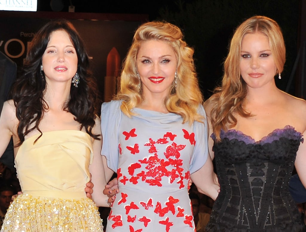 Andrea Riseborough, Madonna and Abbie Cornish pose together on the red carpet.