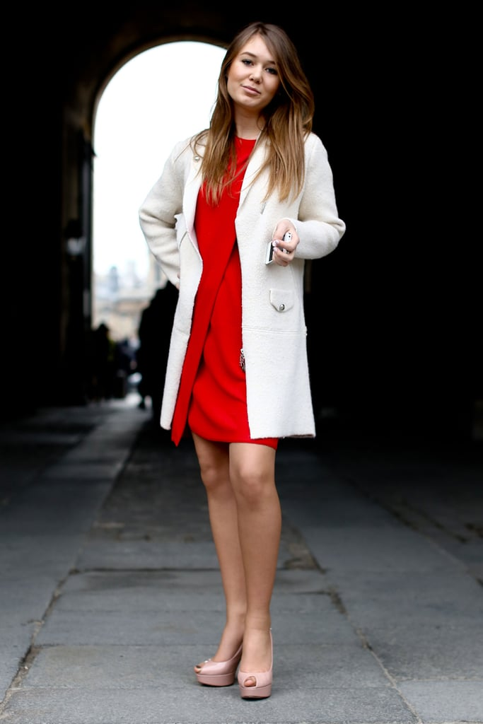 A little red dress livened up a creamy coat and nude platforms.