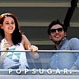 Kristen Stewart and Sam Claflin smiled big.