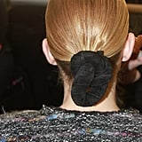 """We wanted something pure, but not just a ponytail. We wanted a touch of sophistication, and the knot was like the final touch,"" Gilbert said. ""It's a bit like a boat knot in a way."""