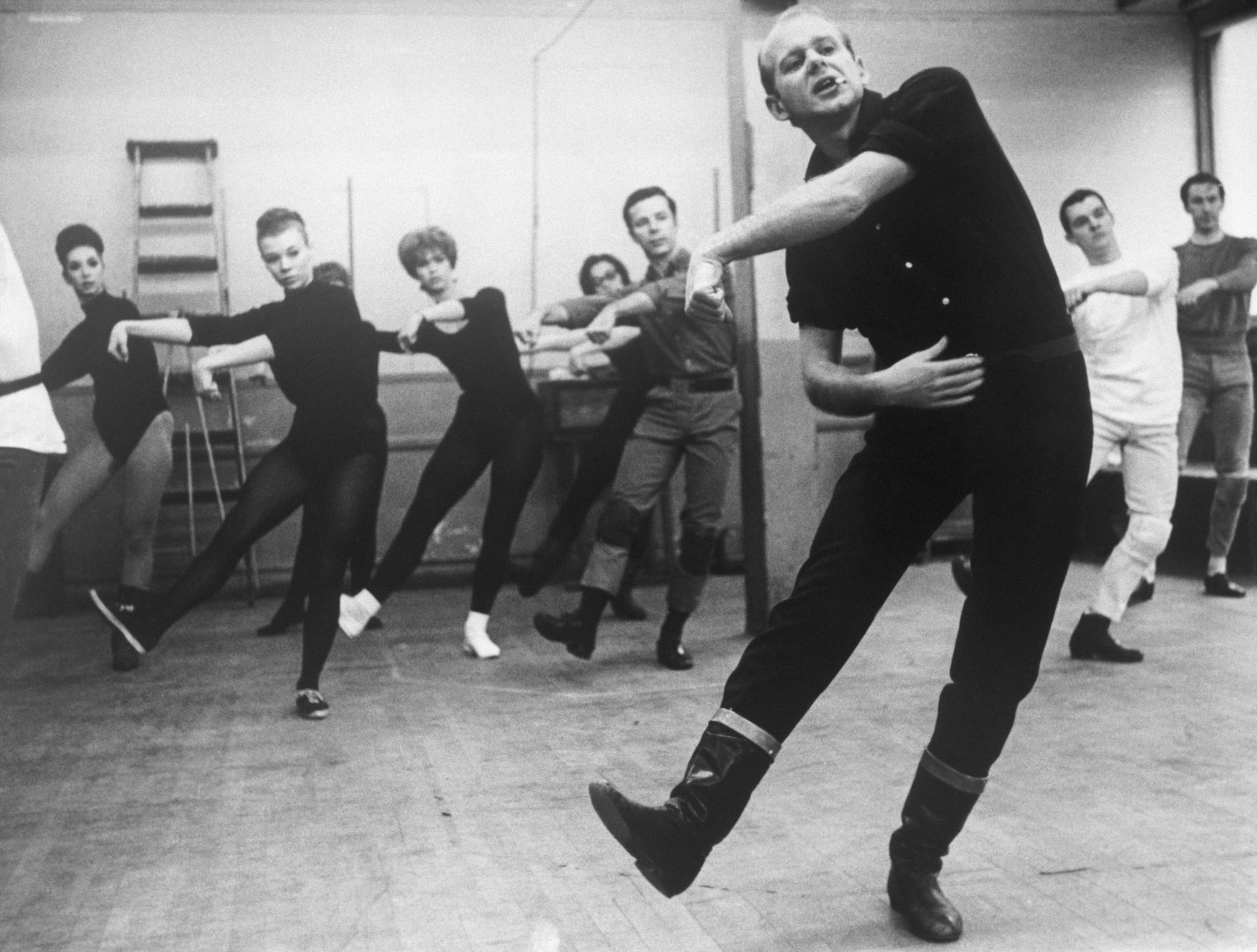 Choreographer Bob Fosse leads dancers for the musical