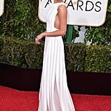 Alicia's crisp white Louis Vuitton apron dress made plenty of best dressed lists on the night of the Golden Globes.