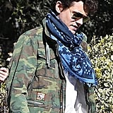 John Mayer wore a blue scarf and an army jacket.