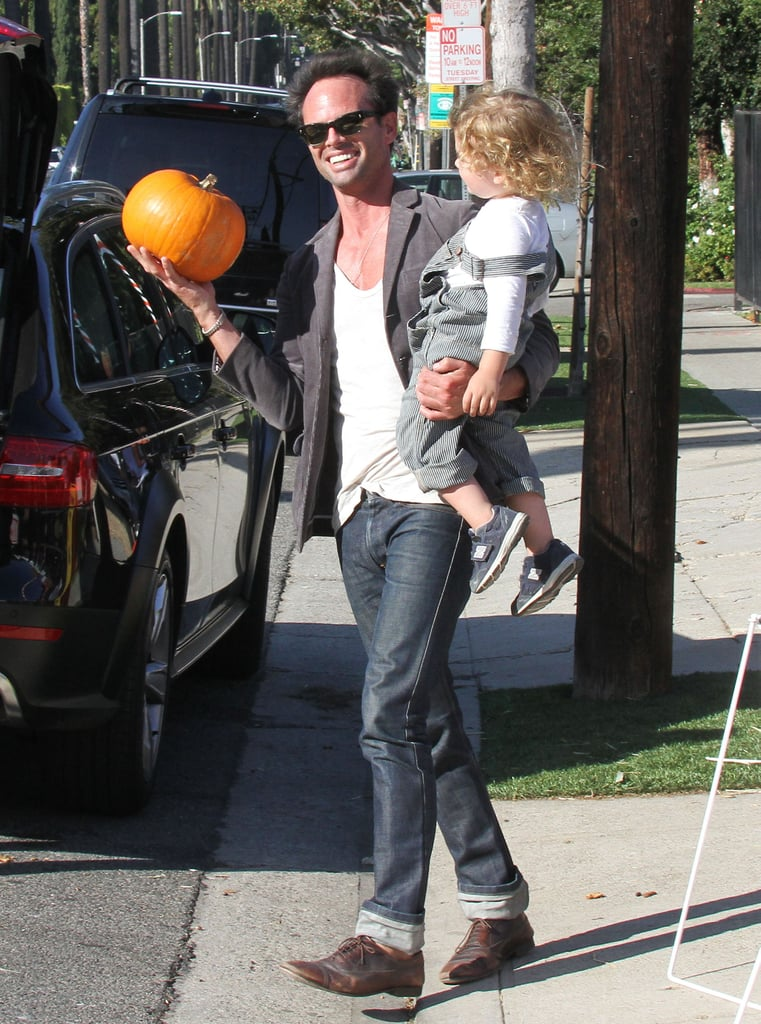 Walt Goggins picked up a tiny pumpkin in LA during a family trip to a patch.