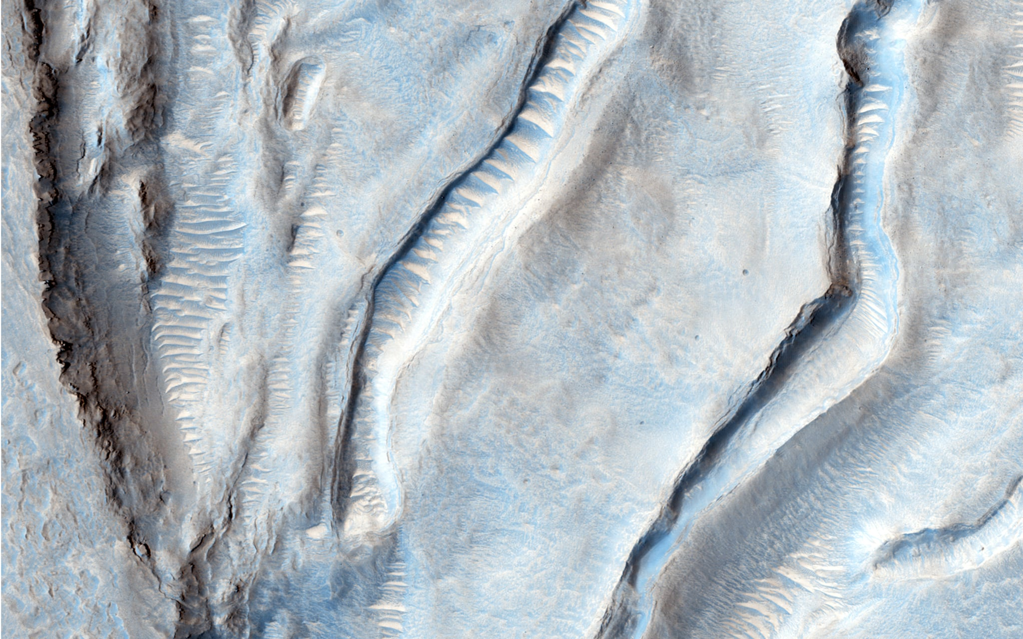"""""""Oxus Patera is an ancient, eroded depression in northern Arabia Terra. It is not known how Oxus Patera formed, though it has been suggested that the feature represents an ancient caldera formed through collapse and explosive volcanism."""" Source: NASA/JPL/University of Arizona"""
