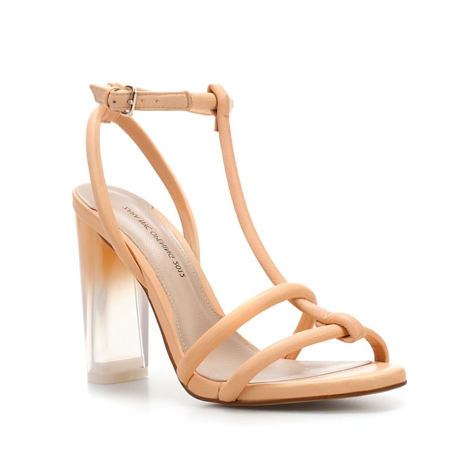 How chic are these heels? We're in love with the ombre-tinged lucite heel.