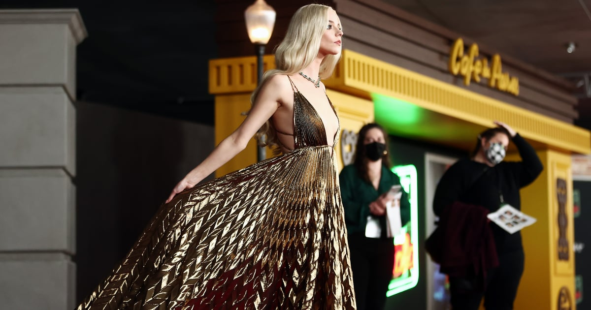 Anya Taylor-Joy Sweeps the Red Carpet in a Gold Pleated Dior Dress For the Ages.jpg