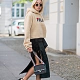 Wear a deconstructed wrap skirt with a fuzzy sport sweatshirt and heels.