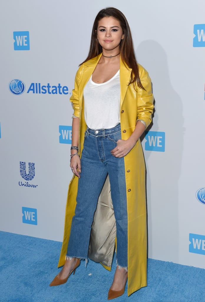 350da807d6d1 Her bright yellow floor-length duster jacket made a simple outfit of jeans  and a