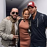 Yandel and Enrique Iglesias surrounded Jennifer Lopez at a press conference to announce their tour in LA.