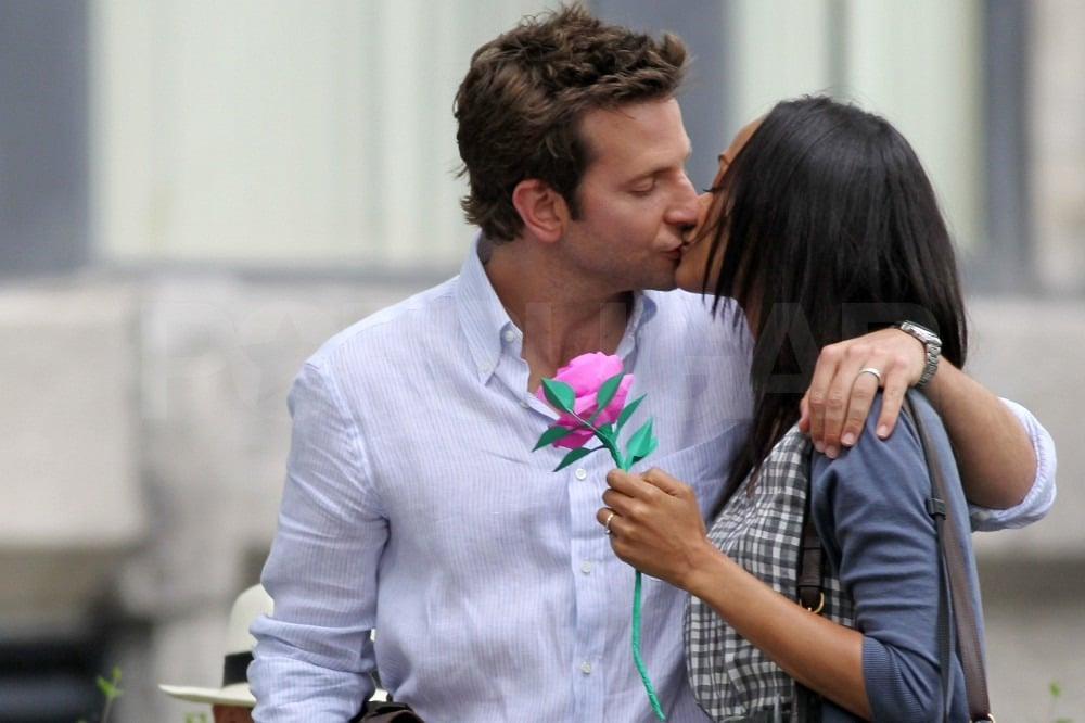 Bradley Cooper and Zoe Saldana were caught in a lip-lock on the set of The Words in Montreal on Tuesday. He's coming off the success of The Hangover Part II, which has already grossed more than $200 million worldwide, and she recently returned from a fashionable stay in Cannes, France. On screen, Bradley's making out with Zoe, but off the clock he's been linked to costar Olivia Wilde. Olivia and Bradley were spotted together last month at Justin Timberlake's SNL afterparty and again more recently on the West Coast though her rep maintains that Olivia Wilde is single and not dating Mr. Cooper. Olivia Wilde wasn't around for Bradley and Zoe's loved-up scenes, but she was cozied up to another good-looking guy earlier this week to celebrate Ryan Reynolds's Details magazine cover. Zoe has her own real life love to tend to, since she's engaged to actor Keith Britton.