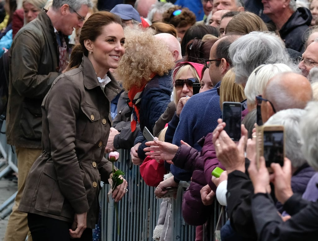 The Duke and Duchess of Cambridge paid a visit to the town of Keswick in the UK's picturesque Lake District on Tuesday, where they were set to attend a reception with people from the local community who are making a difference in the area. The couple were also set to meet farmers and even try their hang at sheep shearing, so it should come as no surprise that Kate kept her look casual, opting for an ensemble we've seen from her many times before. The duchess revisited a look she wore to visit the Scout Association headquarters earlier this year, opting for a utility jacket teamed with skinny jeans and her See by Chloé lace-up ankle boots. It looks like the duchess is sporting a high-necked ruffled blouse and sage green sweater under her jacket. Take a closer look for yourself ahead.