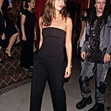 Wearing a strapless top and wide-leg trousers in 1998.