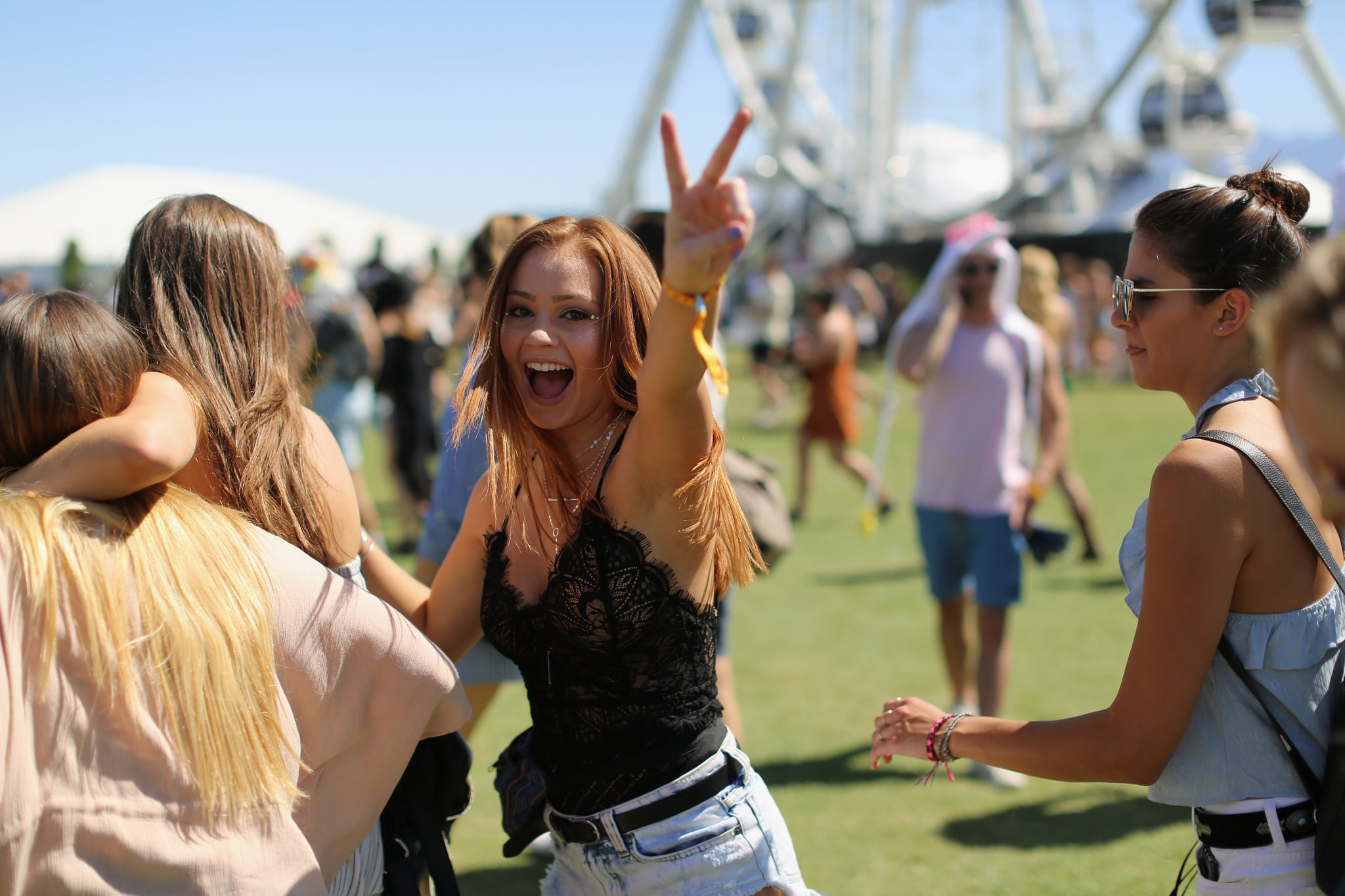INDIO, CA - APRIL 14:  Festivalgoer gives the peace sign during day 1 of the Coachella Valley Music And Arts Festival (Weekend 1) at the Empire Polo Club on April 14, 2017 in Indio, California.  (Photo by David McNew/Getty Images for Coachella)