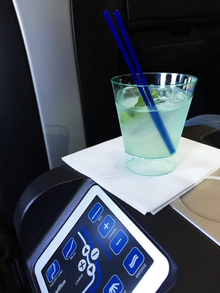 We were promptly served a tasty RefreshMint cocktail before takeoff — honey-infused limeade and fresh mint with vodka. Word of caution: the spot for the drinks on the center divider was a little precarious for when you need to get up and pass the person beside you.