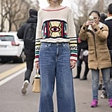 An Embroidered Jumper With Raggedy Denim and Caged Shoes