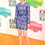 Kristen wore a feminine blue lace Stella McCartney mini with matching suede pumps for the Kids' Choice Awards in March 2012.