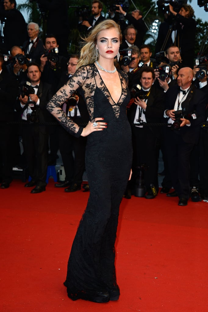 Cara Delevingne was a knockout in a lace, peekaboo Burberry gown.