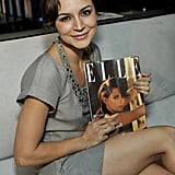Samaire Armstrong — wearing an AX Jewel Collar Dress ($99, originally $130) had a solo moment with her copy of Elle.