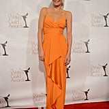 Julie Bowen went for orange on the red carpet.