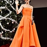 Lily Collins continued the promotional tour for her movie Love, Rosie. The actress wore a vibrant orange dress in Tokyo.