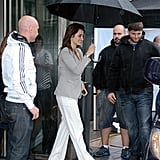 Penelope Cruz walked to the car shielded by an umbrella.