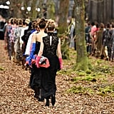 Models Walked Through the Forest in Perfectly Aligned Rows