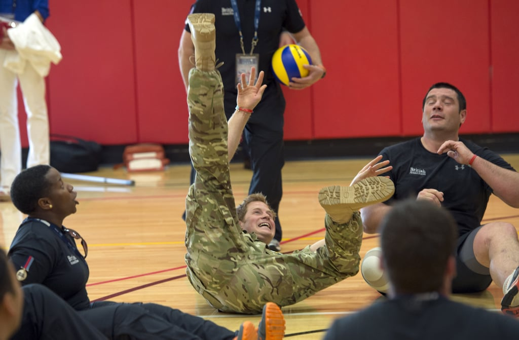 In Colorado Springs, CO, Prince Harry tumbled while trying to save a ball while practicing sitting volleyball with UK service members on Saturday.