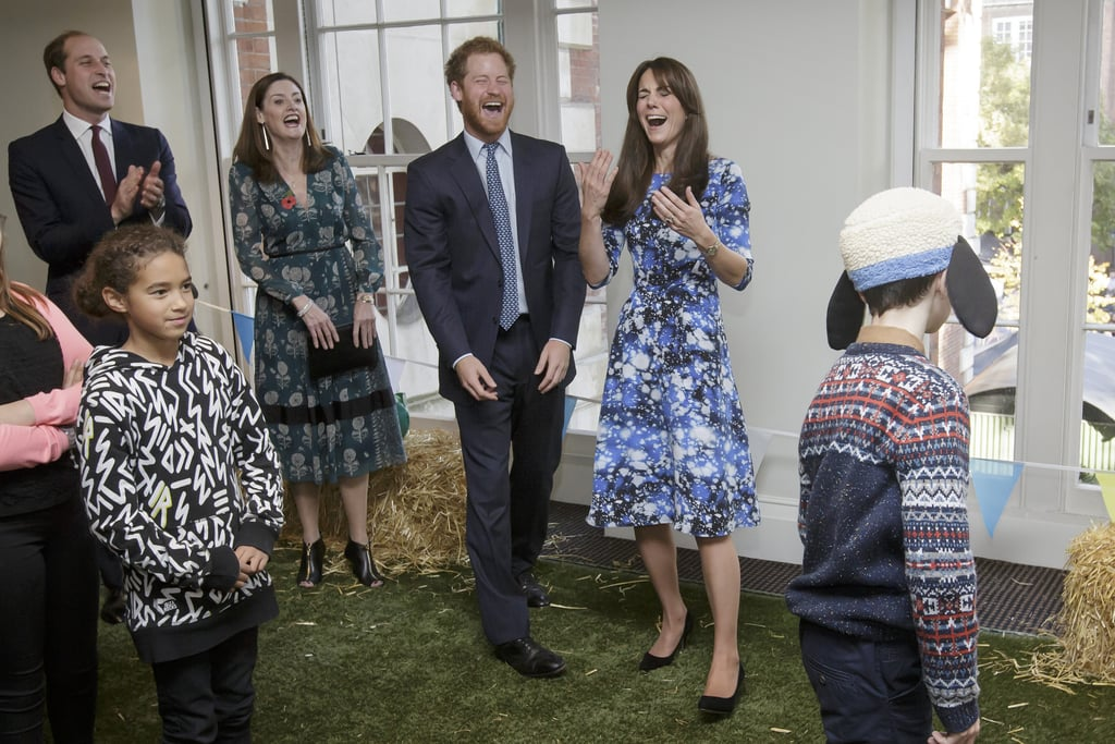 """Kate Middleton was joined by her husband, Prince William, and his brother, Prince Harry, for an appearance at the British Academy of Film and Television Arts' London headquarters on Monday. She wore a space-print dress by designer Tabitha Webb>/a>. The trio was on hand to cohost the premiere of the children's animated special Shaun the Sheep: The Farmer's Llamas; they introduced the special to an audience of kids and spent sweet quality time with them, playing a """"Welly Wanging"""" toss game and doing cute crafts. We've seen quite a lot of Kate, William, and Harry these past couple months. Most recently, Kate and Will had an adorable outing in Scotland, and Harry showed off his sexy facial scruff at an Armed Forces ceremony at St Paul's Cathedral in London. Keep reading to see photos from the latest royal appearance, and then find out 30 fascinating facts about Kate Middleton."""