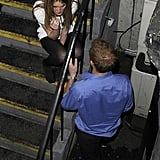 Prince Harry talking to a mystery girl in London.