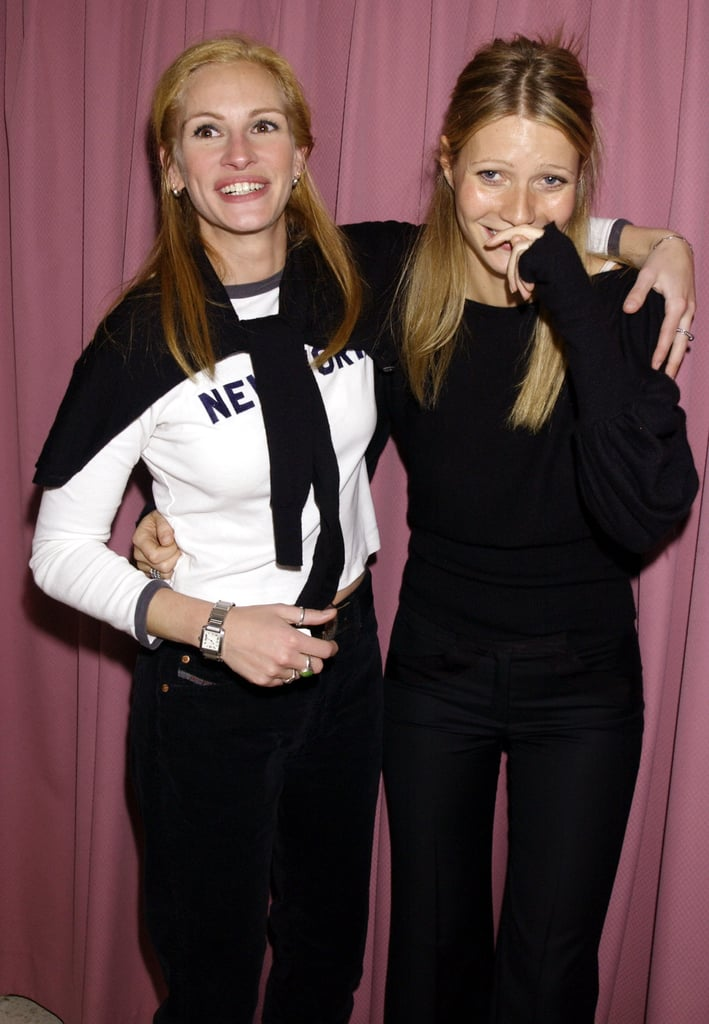 Julia shared a giggle with pal Gwyneth Paltrow at a charity event in 2001.
