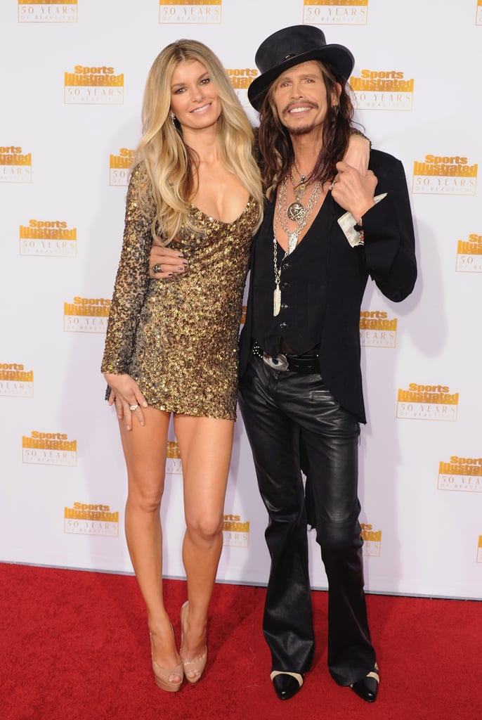 Steven Tyler managed to outshine all of the leggy models at the 50th anniversary celebration of Sports Illustrated's annual swimsuit issue in Hollywood on Tuesday night. The Aerosmith front man bared his chest in a low-cut vest and playfully posed with a top hat on the red carpet when he wasn't wrapping his arm around the beautiful Marisa Miller. The event was full of former Sports Illustrated cover girls, including Kate Upton, Tyra Banks, Heidi Klum, and Christie Brinkley, the latter looking much younger than her 59 years. Keep reading for pictures from the red carpet and be sure to vote on your favorite sexy look from Sports Illustrated's anniversary bash.