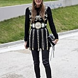 Anna Dello Russo donned a gladiator-chic exterior in Paris, wearing her signature veiled Jil Sander beanie.